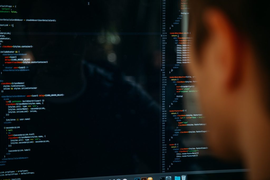 a man on his computer coding