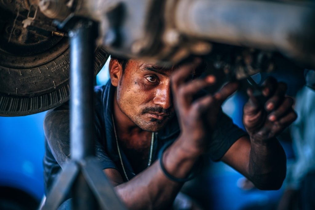 a man works on a car