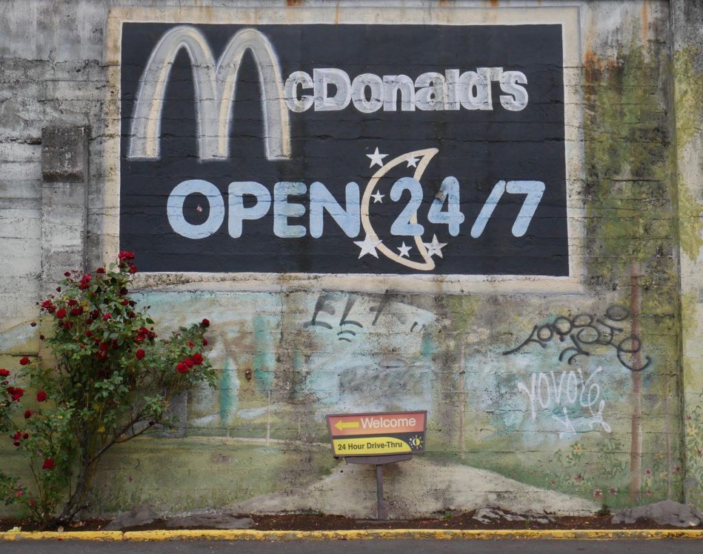 a faded mural for McDonalds 24 hour drive through
