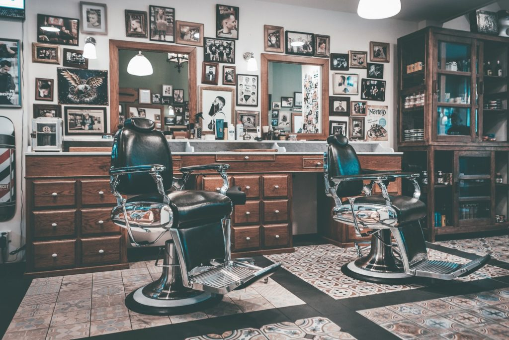 an empty barber shop with pictures on the wall