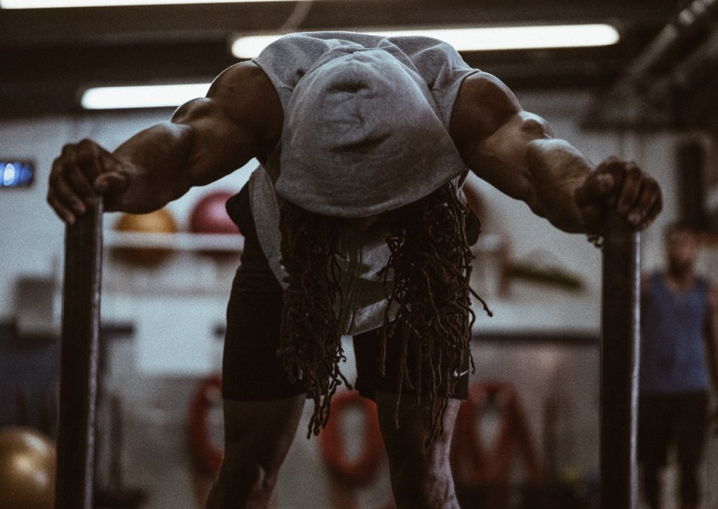 a man with long dreads exercises