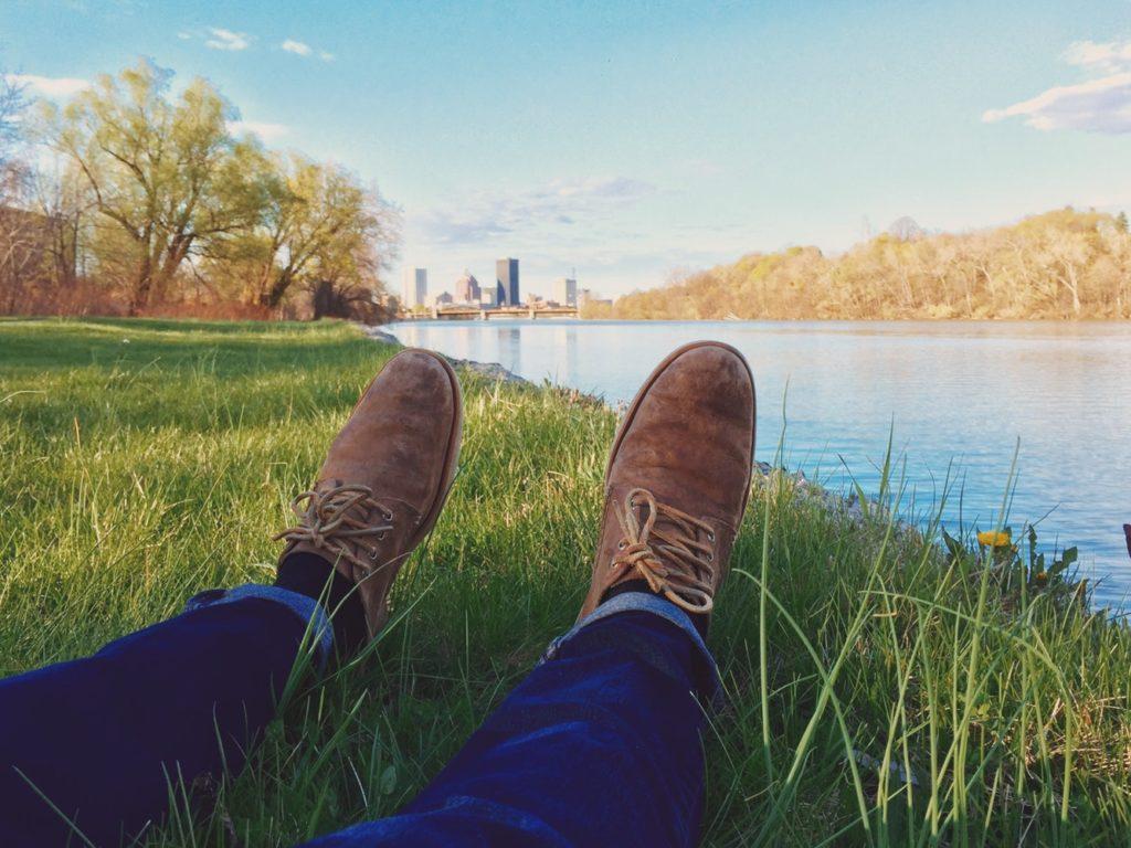 a man reclines on the grass
