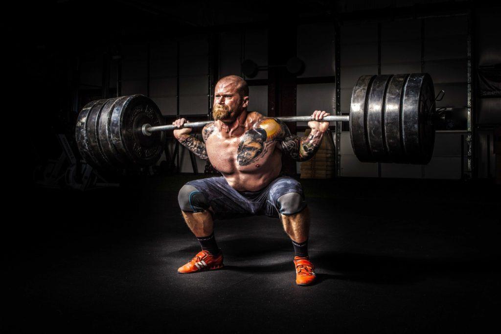 a man lifts a huge weight