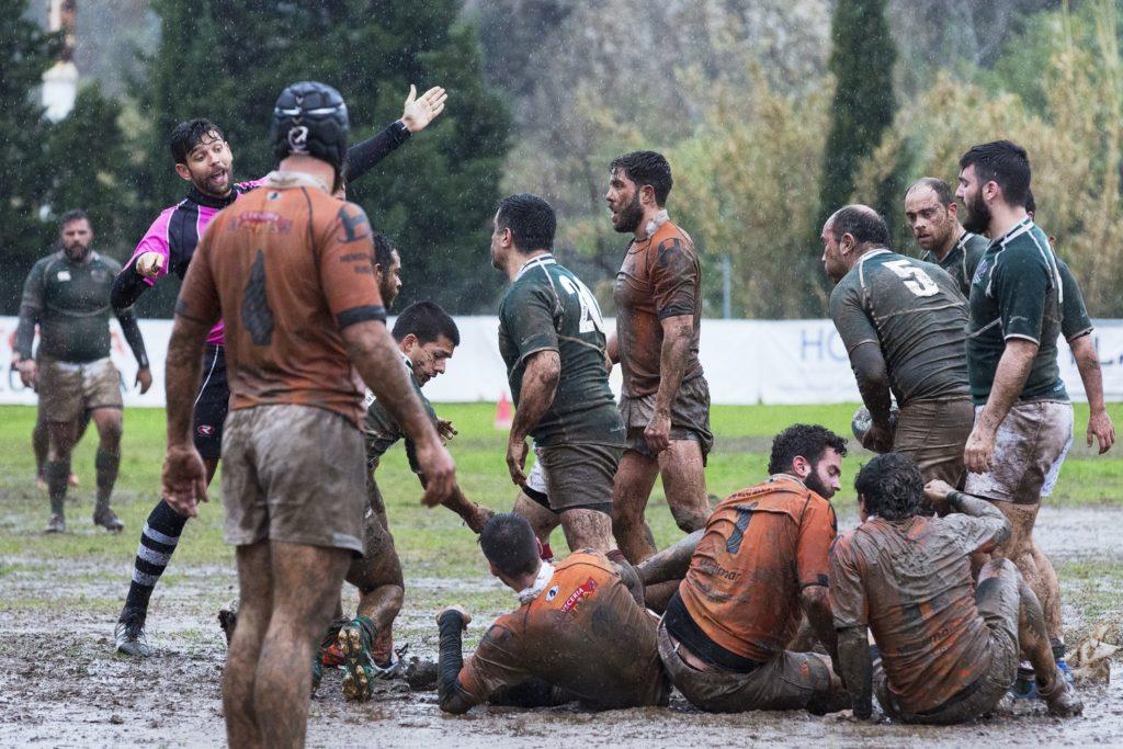 men playing football muddy