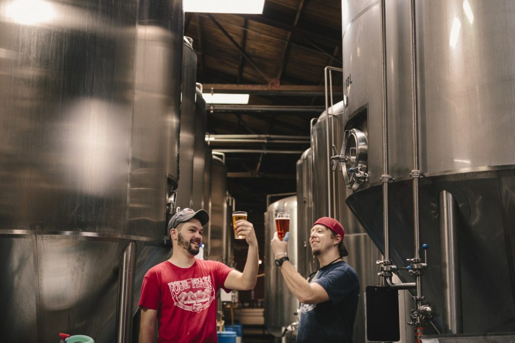 two men trying beer in a brewery