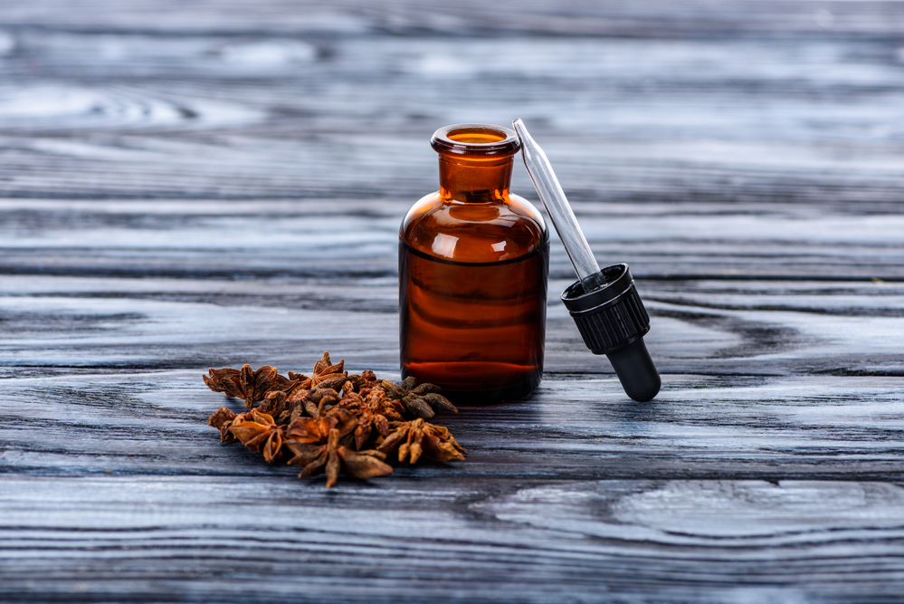 a brown bottle of an essential oil for fighting hair loss
