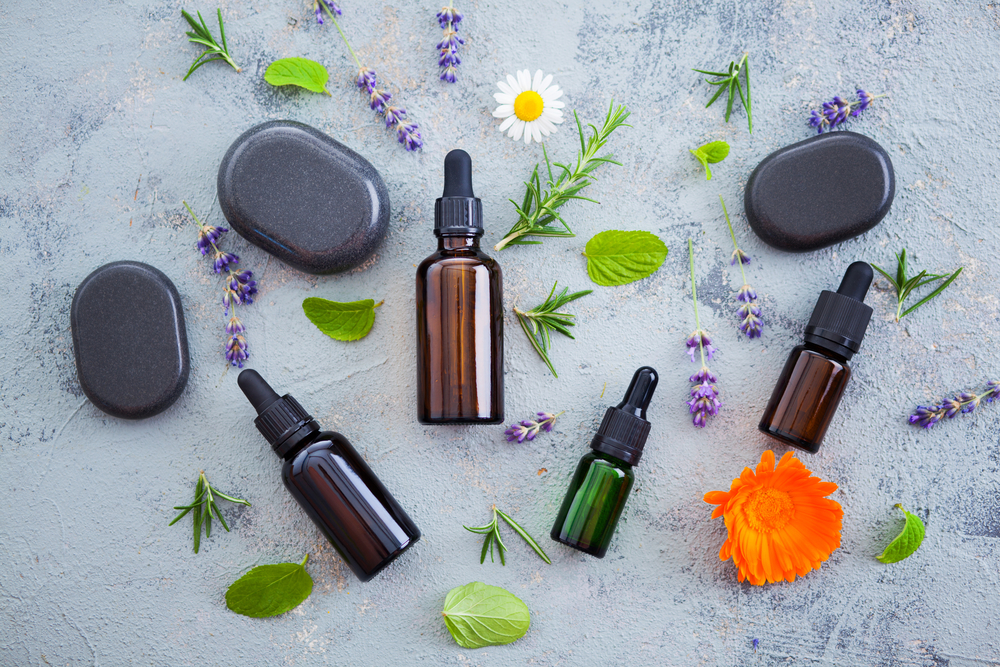 oil and fresh herbs for holistic hair health