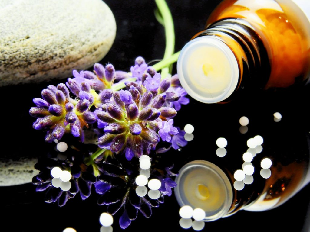 close up of essential oils bottle and lavender