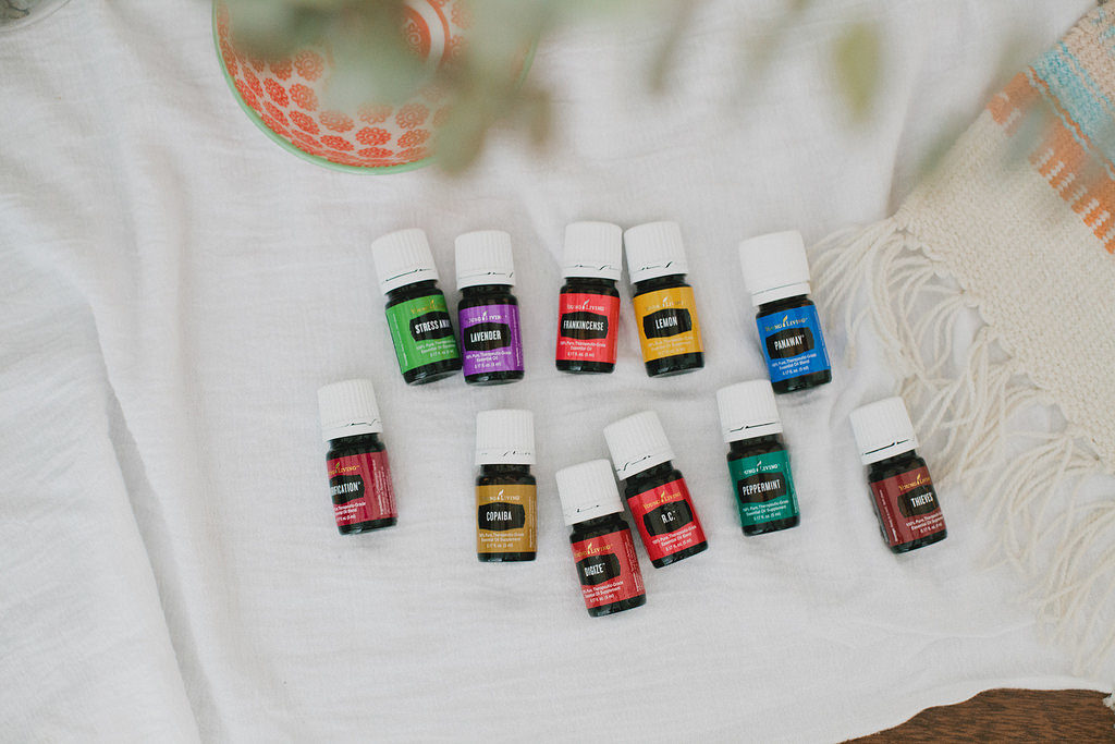 a random assortment of colorful essential oils bottles